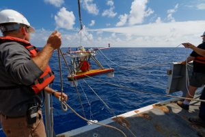 The deployment of the HPIES (Horizontal Electrometer Pressure Inverted Echosounder) instrument off the fantail of the Thompson at the Axial Base site. The instrument was designed to freefall to the seafloor from the surface, and did so successfully.  	Photo Credit: Ed McNichol, Mumbian Enterprises, Ltd.
