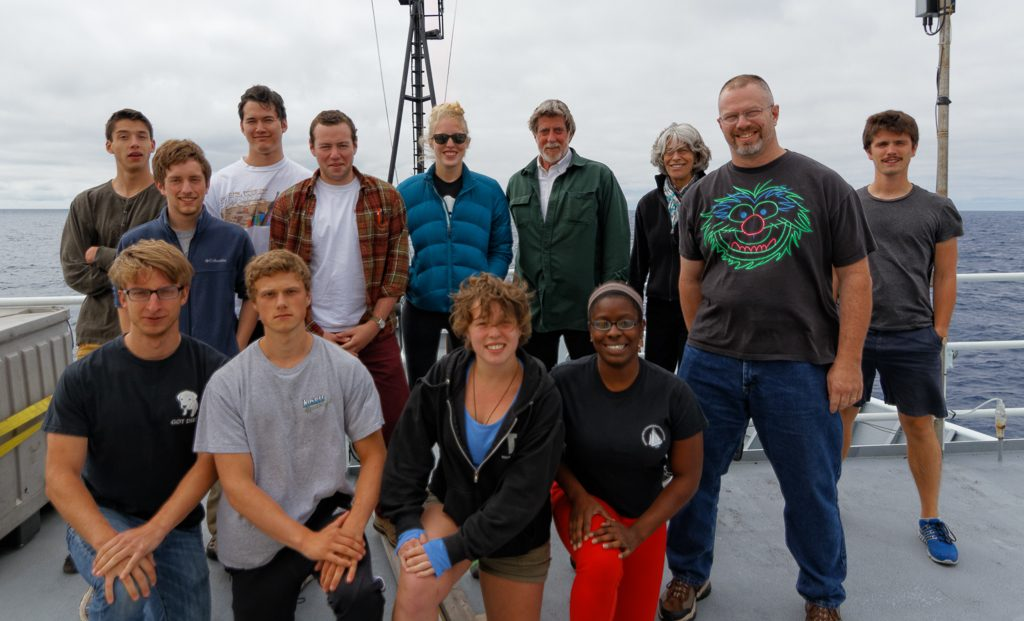 Eleven students from the University of Washington, University of Oregon, and Boston University are participating on Leg 2 of the VISIONS'14 expedition as part of the School of Oceanography experiential learning course 'Ocean 411'. Also shown is John Delaney (Chief Scientist - University of Washington) and Kendra Daly (Co-Chief Scientist - University of South Florida). Photo Credit: Ed McNichol, University of Washington, and Mumbian Enterprises; V14.