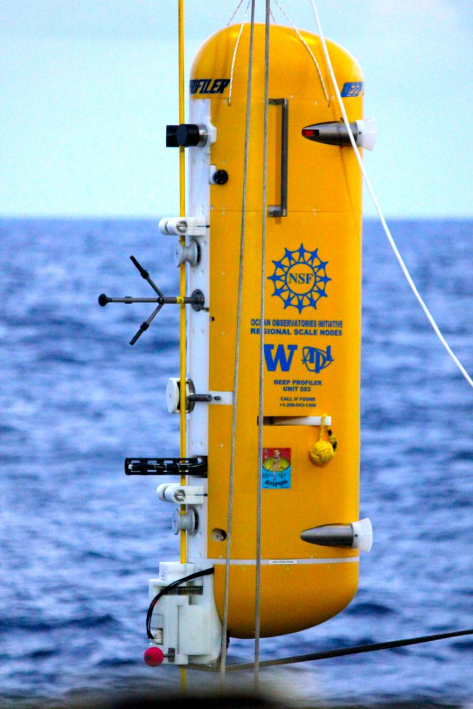 An RSN deep profiler is prepared by engineers on board the Thompson to be deployed to study the deep ocean.