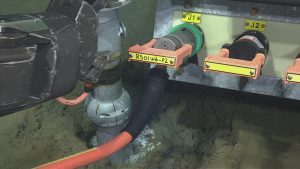 The port arm of ROPOS seating the plug connector of RS01W6 to J1 on Low Voltage node LV01A at the Slope Base site.  	Photo Credit: NSF-OOI/UW/CSSF; Dive 1734; V14.