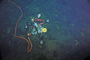 A bottom pressure tilt instrument is installed at the Eastern Caldera Site on the summit of Axial Seamount. Image Credit: VISIONS'13, NSF-OOI/UW/CSSF; Dive R1617; V13