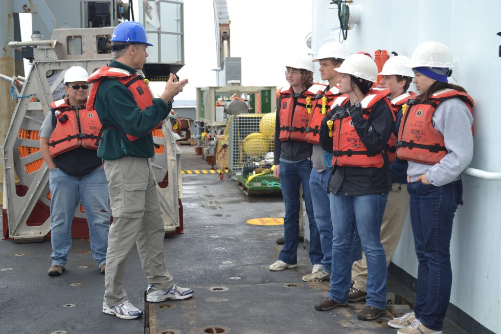 University of Washington undergraduate students learn how a CTD works, the science behind this instrument package, and  how to take water samples during the VISIONS'14 expedition. Image Credit: Mitch Elend, University of Washington; V14.