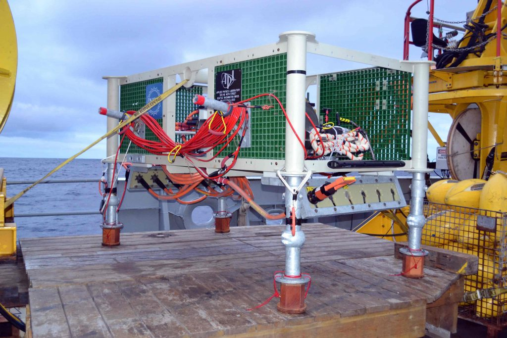 Medium-Power Junction Box MJ03C rests on the platform for ROPOS, awaiting connection to the underbelly of ROPOS. This node was installed on the seafloor during dive R1717.