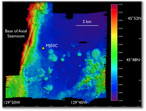 Brendan Philip, a recent graduate from the School of Oceanography undergraduate program, designed and ran this EM302 bathymetric survey in the area where two RSN-OOI moorings will be installed at the base of Axial Seamount. Photo credit: Deb Kelley, University of Washington, V14.