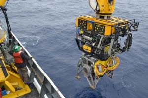 The Canadian ROV ROPOS is latched into the ROCLS cable laying system, taking a 1 km-long extension cable down to the seafloor at the base of Axial Seamount. Photo Credit: Mitch Elend, University of Washington, V14.