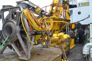 The ROPOS remotely operated cable laying system (ROCLS) is awaiting attachment to the underbelly of ROPOS. The cable will be installed at the base of Axial Seaount. Photo Credit: Mitch Elend, University of Washington, V14.