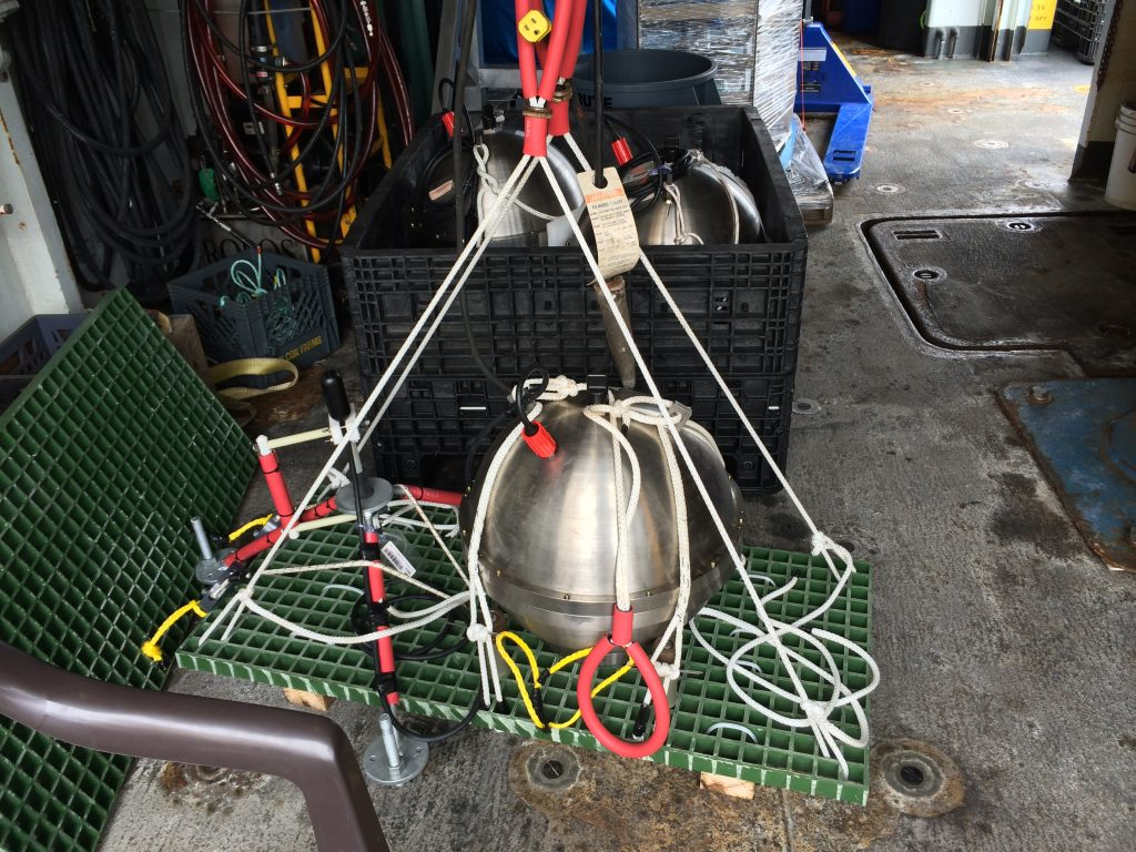 A broadband seismometer and hydrophone are rigged for installion at the summit of Axial Seamount during VISIONS'14. Image Credit: Skip Denny, University of Washington, V14.