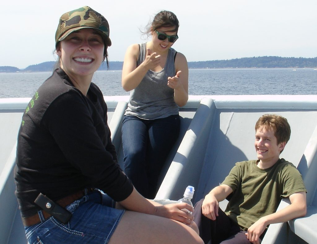 University of Washington students Krista Nunnally, Gina Hansen and Sam Albertson show their excitement for going to sea aboard the R/V Thompson at the start of the VISIONS '14 Expedition. Photo Credit: Leslie Sautter, College of Charleston, V14.