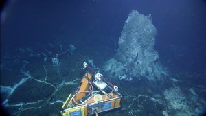 The RSN-OOI high definition camera at the base of the hydrothermal vent called Mushroom during its test dive with ROPOS (Dive 1636). Photo credit: NSF-OOI/UW/CSSF.