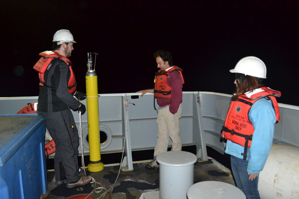University of Washington, School of Oceanography undergraduate student - Charlie Parker- deploys an Argo float over Axial Seamount during the VISIONS'13 program. The float wil submerge to 1000 m beneath the surface, taking chemical measurements along the way, and every 5-10 days will surface and transmit these data over a satellite to shore. Photo Credit: Mitch Elend, University of Washington.