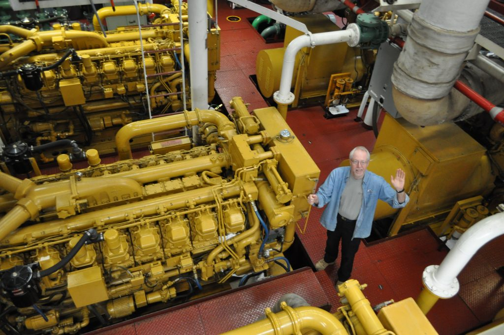 Paul gives a tour of the T/V Thompsons engine room to VISIONS'13 students.
