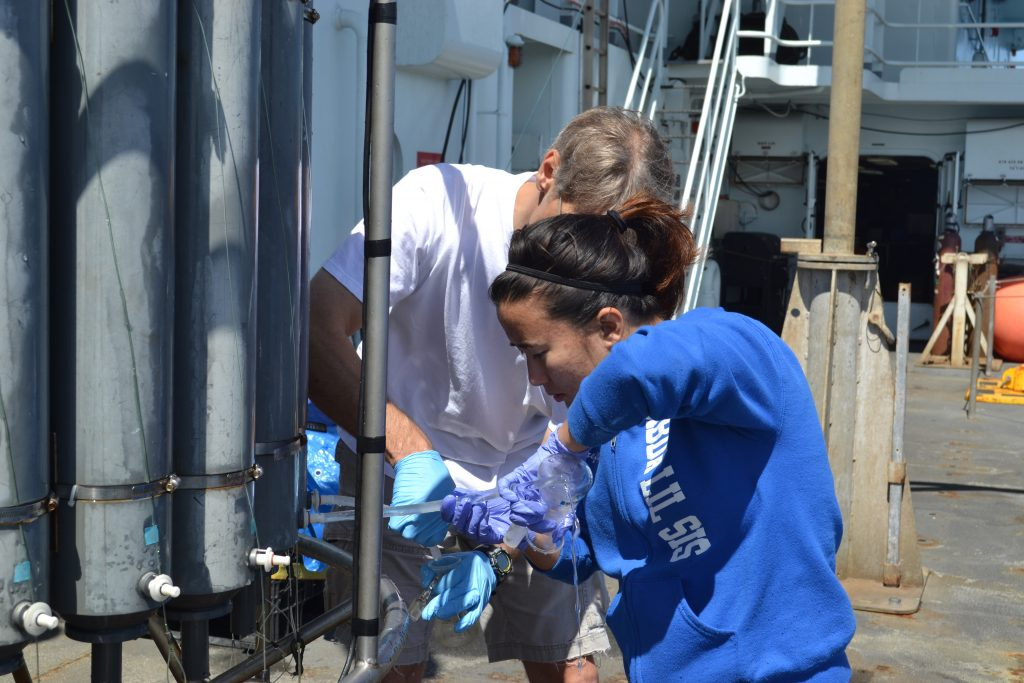 A break in the overcast days brings on great sunny weather for sampling water from the CTD. Photo Credit: Mitch Elend, University of Washingotn.