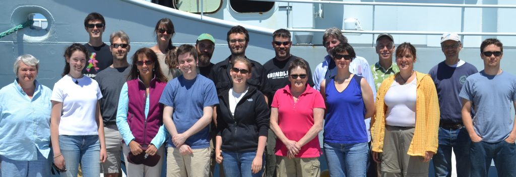 Eight students participated on both Legs 1 and 2. In the front row, from left: Adrian Rembold (2nd), Owen Coyle (5th), Claire Knox (6th), Julie Nelson (in pink), Judy Twedt (in blue), Julie Ann Koehlinger (in yellow), and Rick Berg (on the end). In the back row, from left: Brendan Philip (1st).