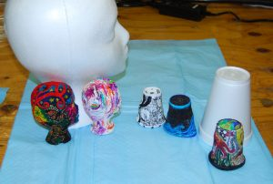 An at-sea tradition is to send styrofoam cups and wig-heads (usually embellished with stylistic artwork) down to the depths so that the overwhelming pressure in the deep sea compresses the objects into miniature versions. (Photo by Leslie Sautter)