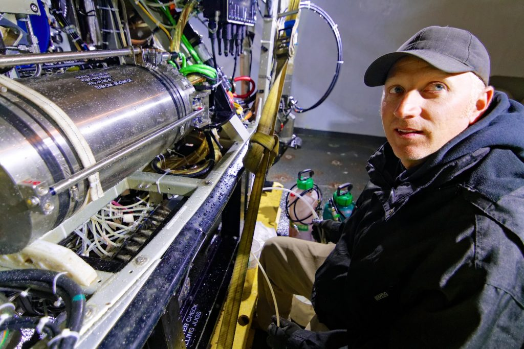 ROPOS pilot and engineer, Josh Chernov, works on the ROV. Photo by Ed McNichol