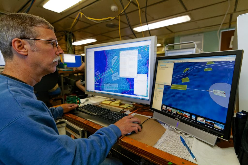 Mitch Elend works on creating maps that the ROPOS team will use as a guide as they lay OOI-RSN extension cables. Photo by Ed McNichol