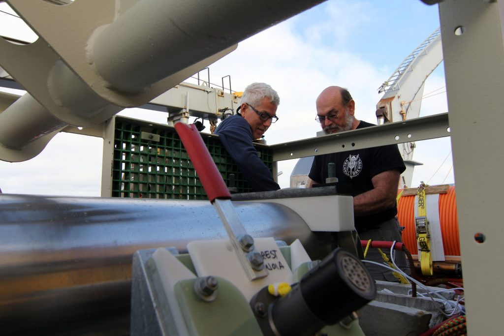 Applied Physics Lab engineers Geoff Cram and Skip Denny (left to right) prepare the secondary node for deployment at primary node 1A. (photo: Allison Fundis)