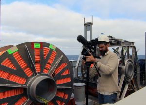 Videographer Ben Fundis captures action on the fantail. (photo: Allison Fundis)