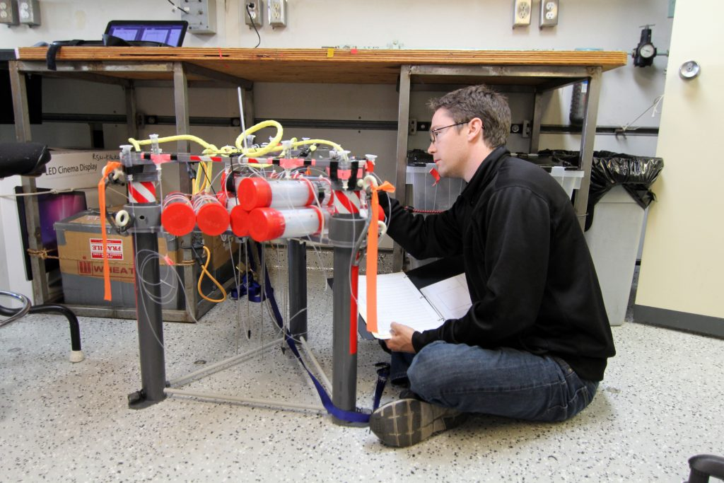 Graduate student Rick Berg, readies the Mosquito instrument that will be deployed at Hydrate Ridge to measure fluid flow out of and into the sedimented seafloor. (photo: Allison Fundis)
