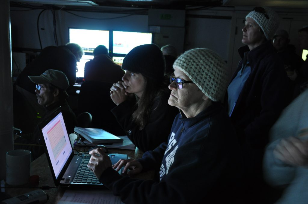 Julie and Allison at the logging station in the control room, making meticulous records of the dive (photo: Judy Twedt)