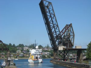 With the railroad bridge up, the Thompson leaves the Ballard Locks and heads for Puget Sound.  	Photo by Mike Mulvihill