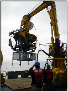 "Some of the special capabilities of ROPOS are that it can lift up to 4,000 lbs and directly couple to Junction Boxes for deployment to the seafloor, such as the one shown here. This was a test deployment of a Junction Box ""shell"", not yet fully outfitted with electronics, cables and sensors conducted in 2011."