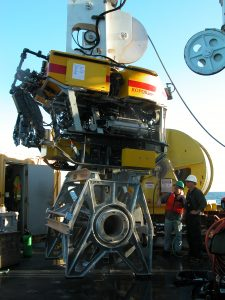 During the VISIONS'13 expedition the ROV ROPOS, installed >22,000 m of extension cables onto the seafloor using the remotely operated cable laying system (ROCLS) shown here attached to its underbelly. The cables will provide power and real-time, two-way communication to a diverse array of instruments and junction boxes.