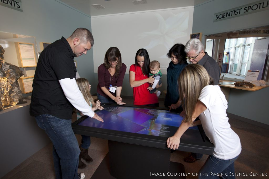Visitors to the Pacific Science Center in Seattle learn about the cabled observatory over an interactive touch screen table.
