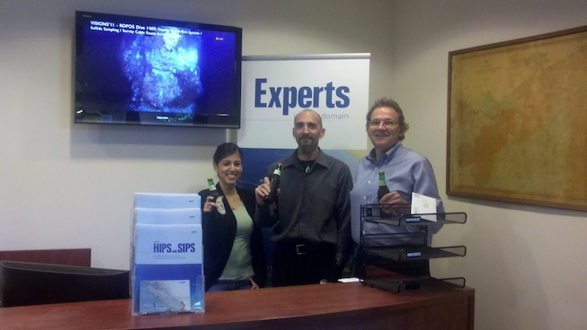 """Members of the Caris team in Alexandra, Va toast to VISIONS'11: """"TO you as you used our newly installed HIPS software for data evaluation over Axial."""""""