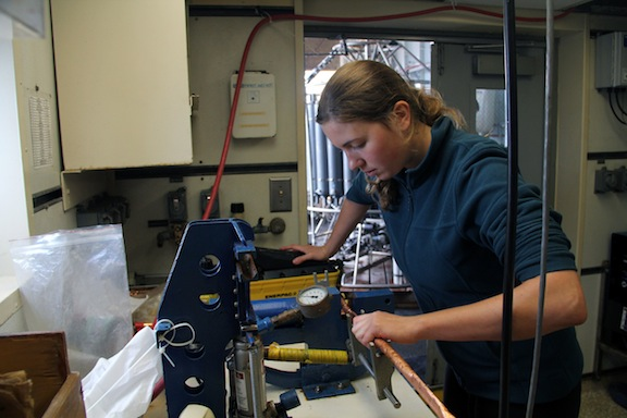 Alexandra Powell from the University of Western Ontario helps to prepare samples from a CTD cast for helium samples. (photo by Allison Fundis)