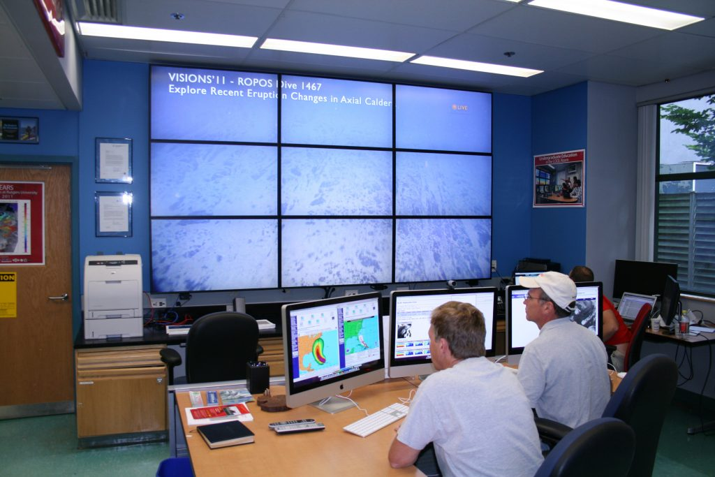 Members of the RU COOL room at Rutgers Univeristy watch the live stream from the VISIONS'11 expedition. (photo courtesy of RU)