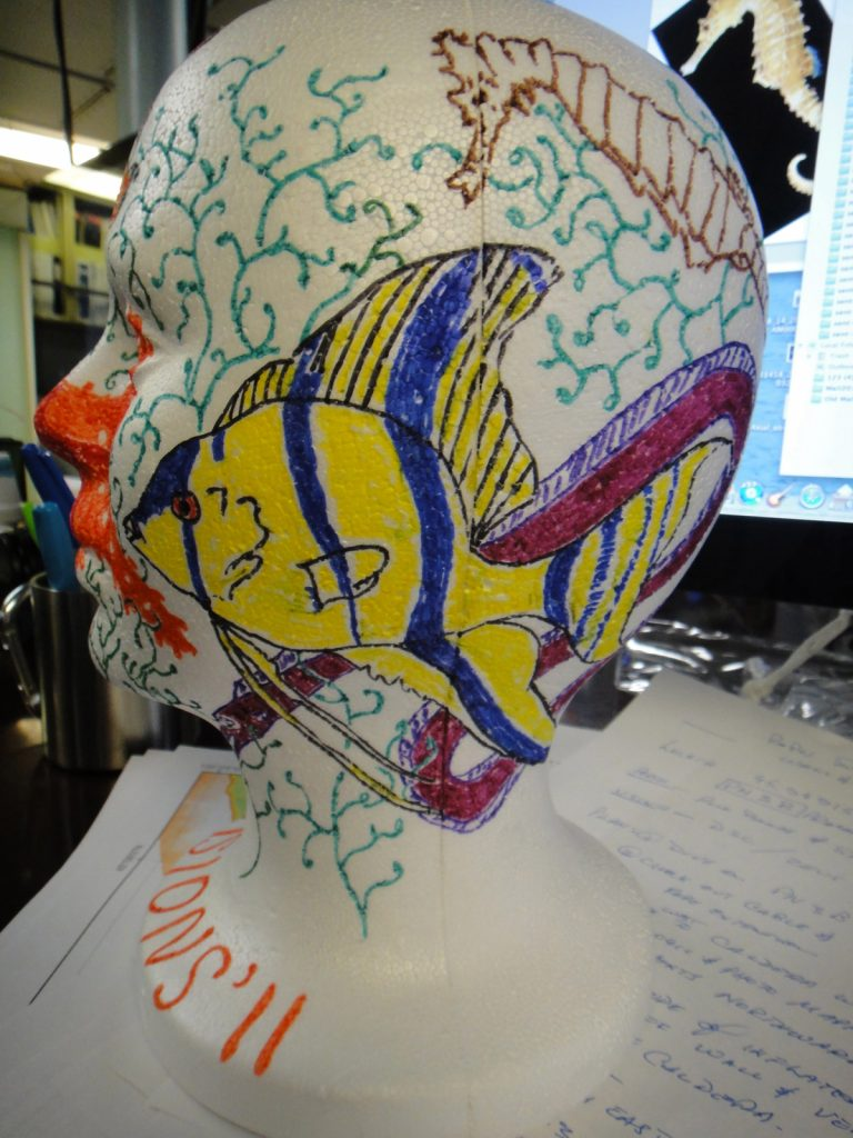 """To highlight the impacts of pressure and for relaxing downtime, it is a common tradition on ROV cruises to color styrofoam heads and cups and take them down to the seafloor. Styrofoam cups come up about 1 inch tall. This head has not yet been """"shrunk"""" but will go down in a few days."""