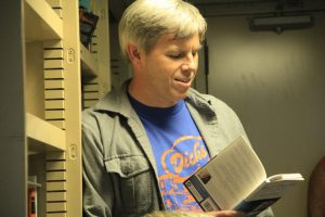 Mike Harrington reads Billy Collins during Bosun's poetry night. (photo by Allison Fundis)