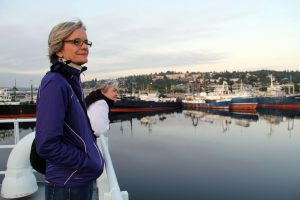 Lisa Graumlich, Dean of UW's College of the Environment, and Debbie Kelley, Co-Chief Scientist, enjoy the view during the transit through Ballard, Seattle. (photo by Allison Fundis)