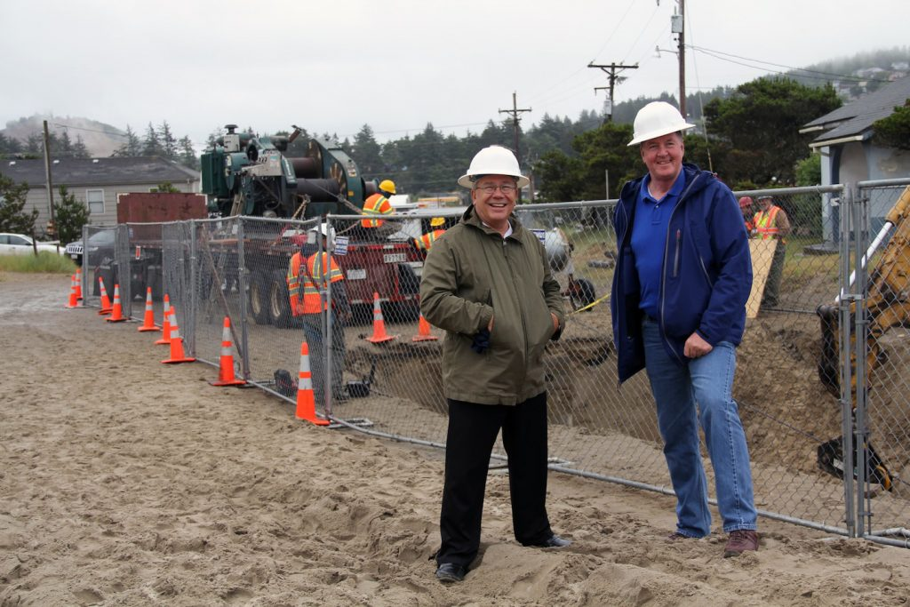 Pete Barletto and Michael Mulvihill of the University of Washington in front of the cable landing work site at the beach manhole in Pacific City, Oregon  ---Photo by Allison Fundis, OOI RSN Education and Public Engagement Liaison, University of Washington.