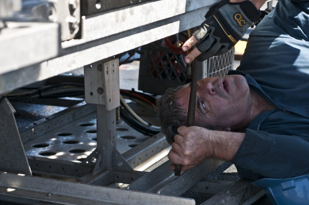 Casey Agee of the Jason team secures the ROV to the drill sled. Photo by Carlos Sanchez