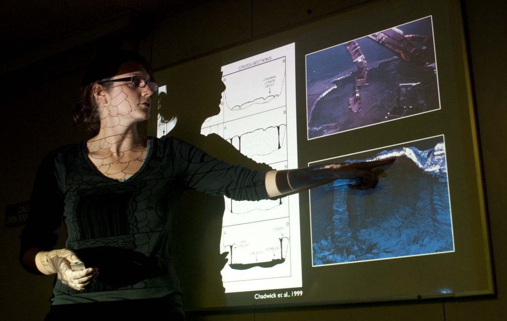 Allison Fundisgives an overview of submarine lava flow dynamics and morphology. Photo by Carlos Sanchez