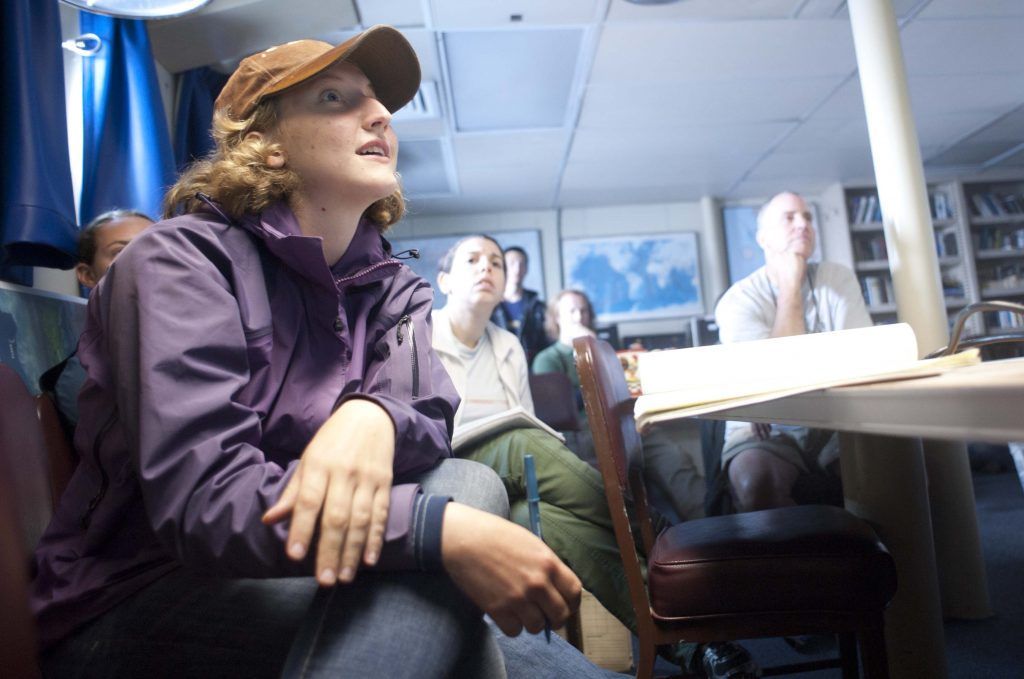 Diane Perry, Bretty Dennis-Duke and David Dyer listen intently to an introduction about Axial Seamount, hydrothermal vents, and submarine lava morphology. Photo by Carlos Sanchez.