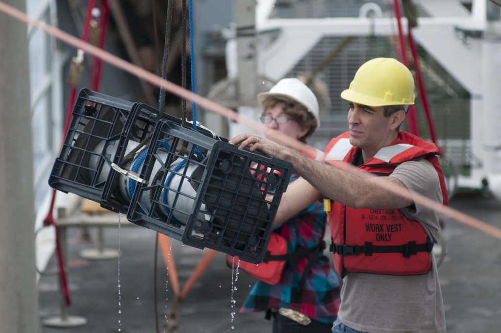 Cody Youngbull and Casey Canfield retrieve ASU's laser housing from 2500m depth. The housing was lowered for a pressure test to test the integrity of the laser housing before sending it down on the ROV Jason. Photo by Carlos Sanchez and Katherine Turner.