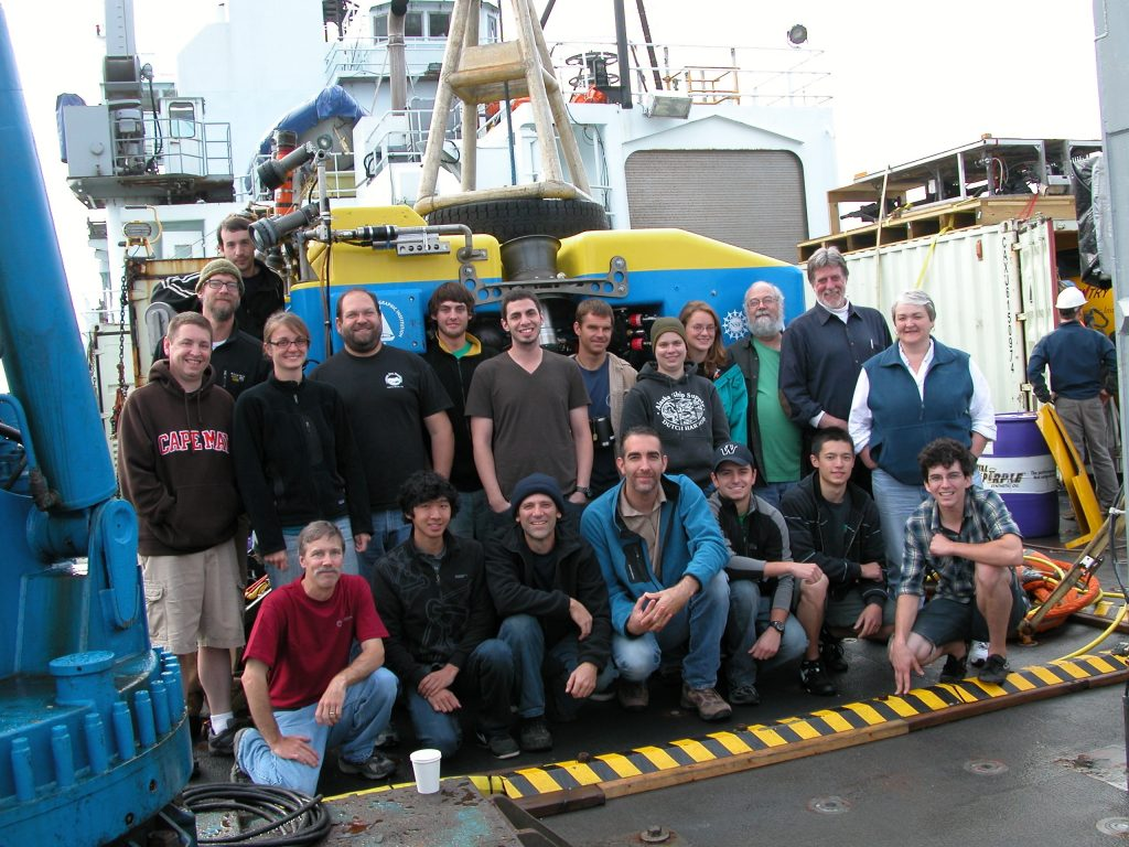Members of the Leg 1 science and Jason teams gather on the fan tail the last day of the cruise.