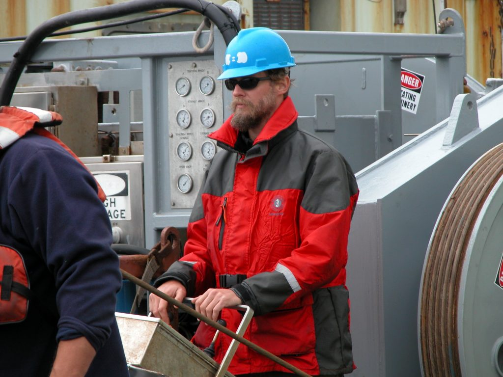 Scott Hansen controls the Dynacon fiber winch during deployment of the test node.