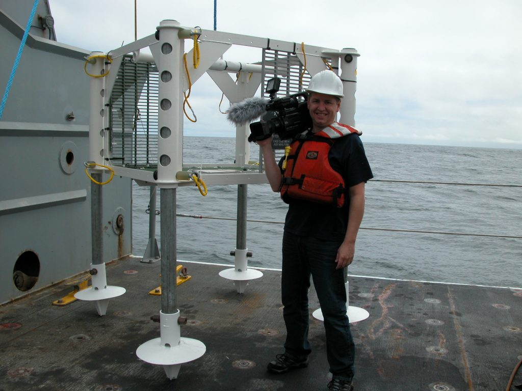 Ed MIcNicol documents deployment of the test frame from the deck of the Thompson.