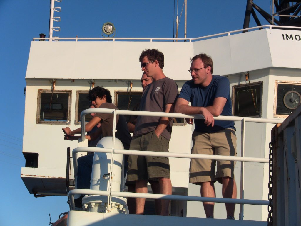 David Granger (far left), Cody Youngbull, Craig Joseph and Peter Kannberg (far right) gathered below the bridge on the R/V Thompson.