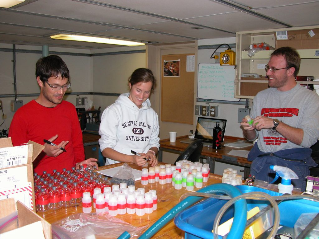 Evan Soloman, Annie Bauer, and Peter Kannberg prepare for the push cores to come aboard from Jason dive 510.