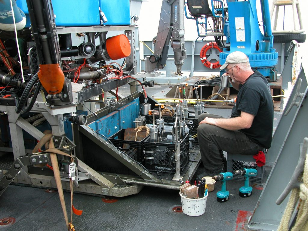 Jim prepares sampling gear for Dive J2-508.