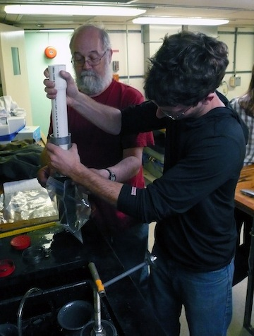 Bob and Craig extract sediment from push cores collected from Jason dive 507.