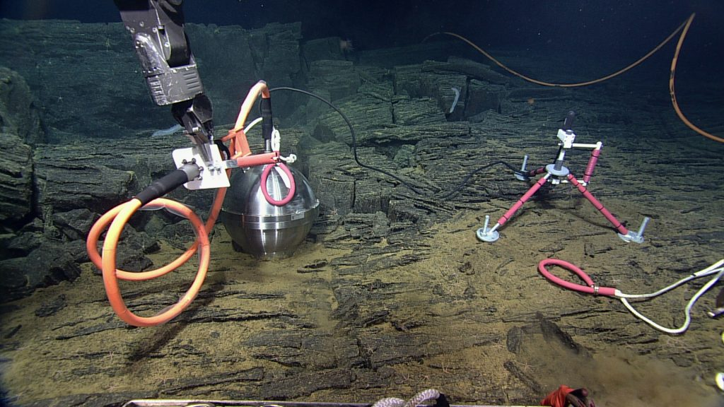 The broadband seismometer and hydrophone being installed at the Central Caldera site on Axial Seamount. Credit: UW/NSF-OOI/CSSF V14