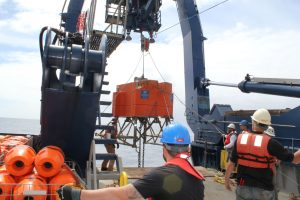 The Shallow Profiler Mooring platform is brought on deck