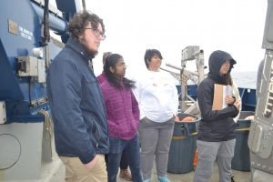 Hayden, Ramya, and Katie learn about CTD operations during Leg 2. Credit: M. Elend, University of Washington.
