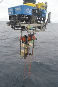 Jason being recovered with a 2018 profiler interface controller (PIC) latched underneath. You can see some biofouling on the platform. Image Credit: M. Elend, University of Washington, V19